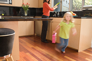 Young girl running in kitchen made by PureBond wood