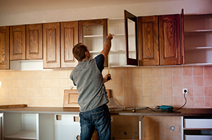 Man installing PureBond wood into a home kitchen